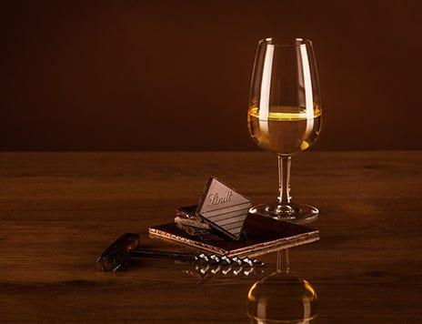 Lindt Excellence Orange Intense Chocolate pairing with glass of Gruner Veltliner wine